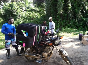 Bags going seven miles by motorbike to clinic