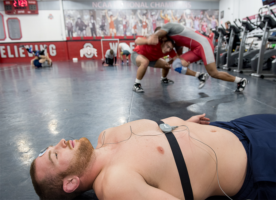 Image of Ohio State Wrestler and Olympic gold medalist Kyle Snyder wearing an Omegawave device during practice