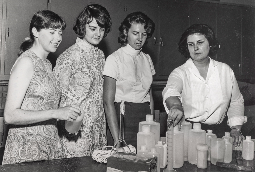 Team members — from left, Eileen McSaveney, Terry Tickhill Terrell, Kay Lindsay and Lois Jones — walk through a lab procedure before their departure.