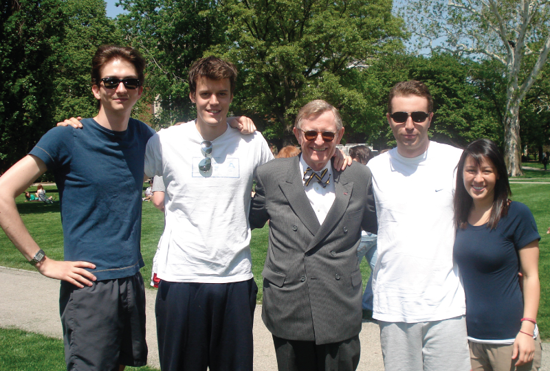 Posing for a pic on the Oval with former President E. Gordon Gee are, from left, Quentin Boulenger, Jean-Marie Letard, Vincent Bodenez and Heather Szozda.