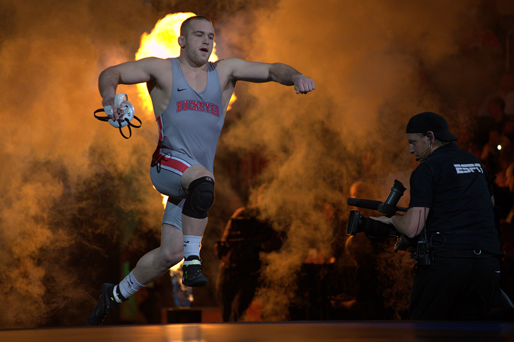 Kyle Snyder runs onto the match prior to his NCAA finals match.