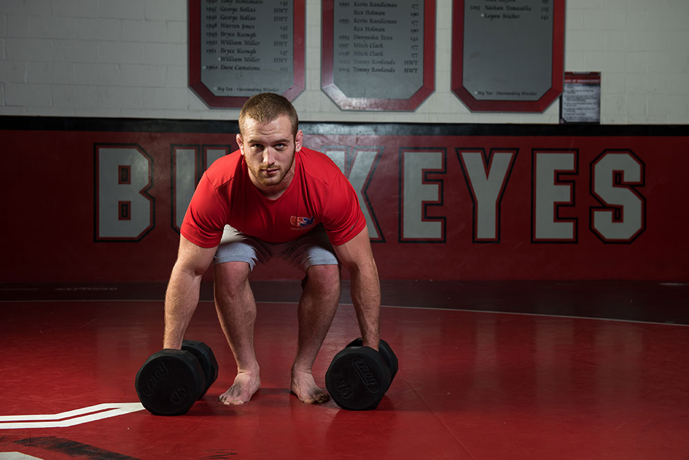 Snyder poses for a photo at Steelwood wrestling facility at Ohio State. (Photo by Jo McCulty)