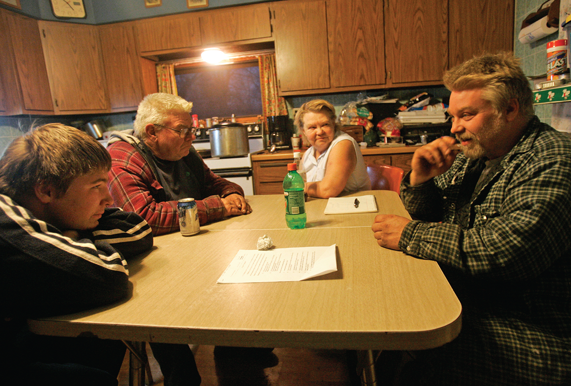 Steven Avery sits at the kitchen table at his family's cabin near Crivitz, Wisconsin, with his parents, Allan and Dolores Avery, and nephew Brendan Dassey.