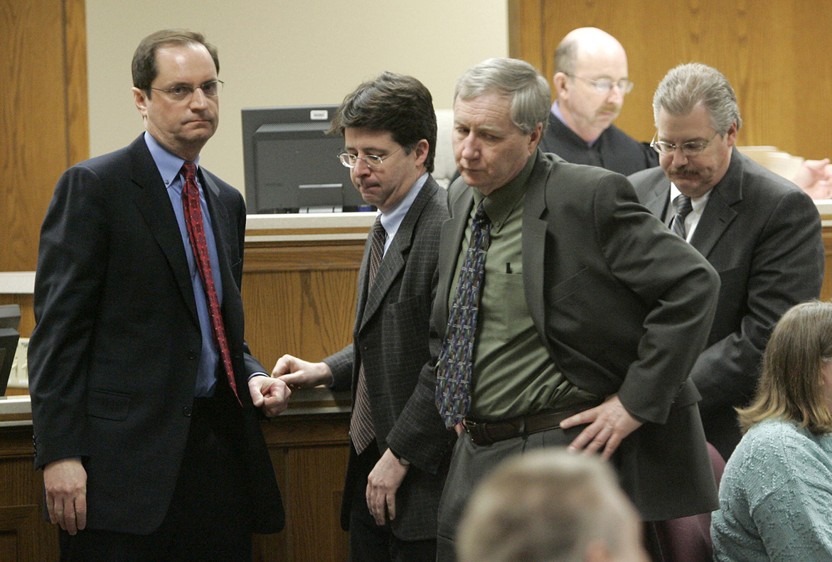 The four lead attorneys in Avery's murder trial are shown in a courtroom. From left are Avery's lawyers, Jerome Buting and Dean Strang; assistant prosecutor Thomas Fallon; and lead prosecutor Ken Kratz. In the background is trial judge Patrick Willis.