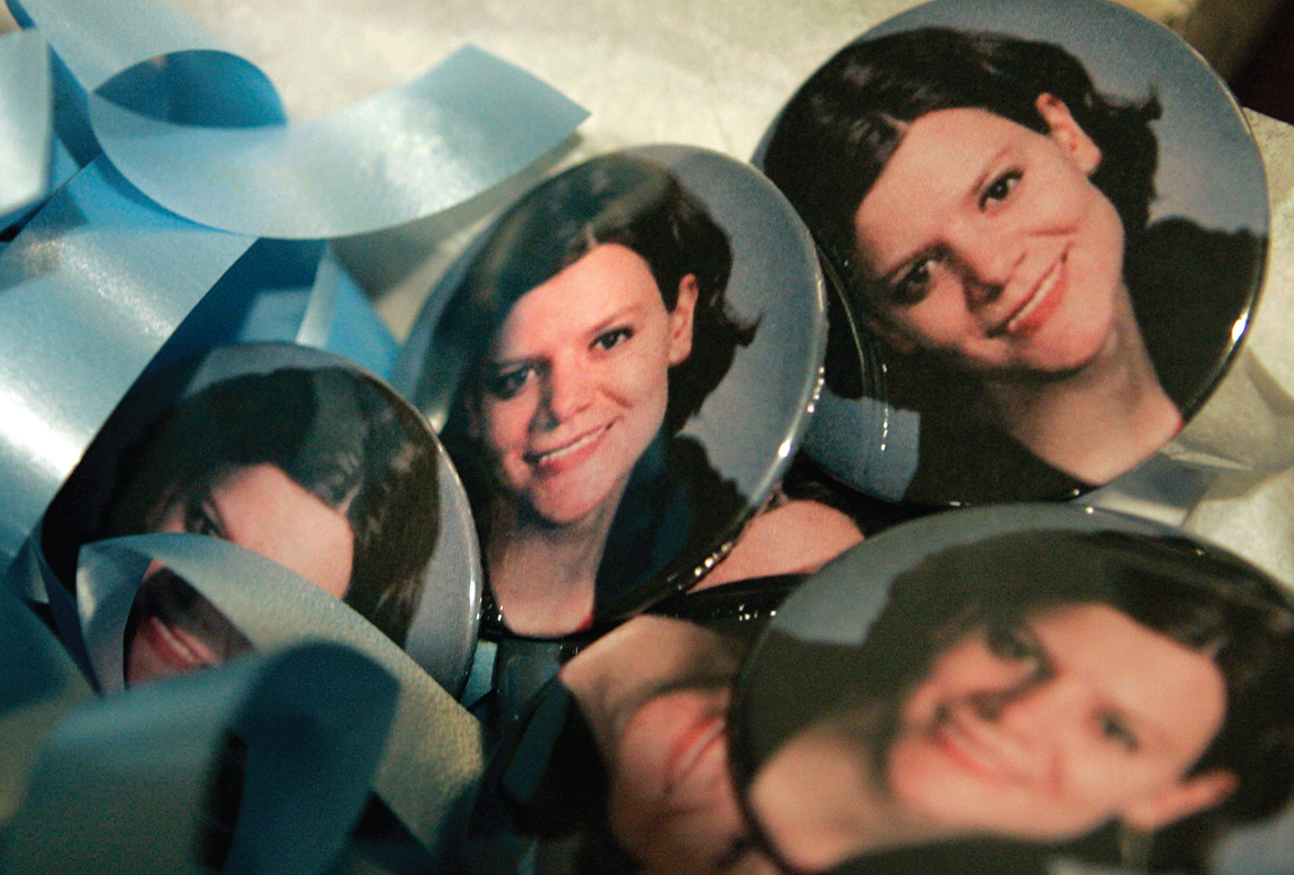 Buttons bearing a photograph of murder victim Teresa Halbach are shown on a table at a memorial service in Green Bay, Wisconsin, two weeks after she disappeared on Oct. 31, 2005.