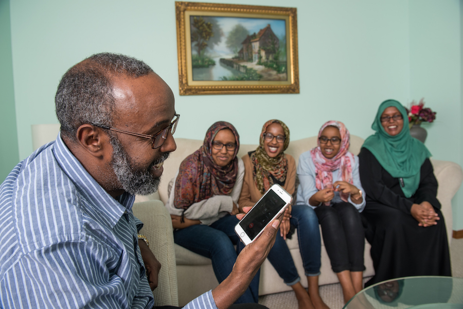 Dahir's family, from left, father Abukar Dahir Osman, sisters Fardowsa, Nima and Fatima, and mother Lina Mohamed enjoy a phone call from Dahir, who is teaching in Turkey as a Fulbright student.