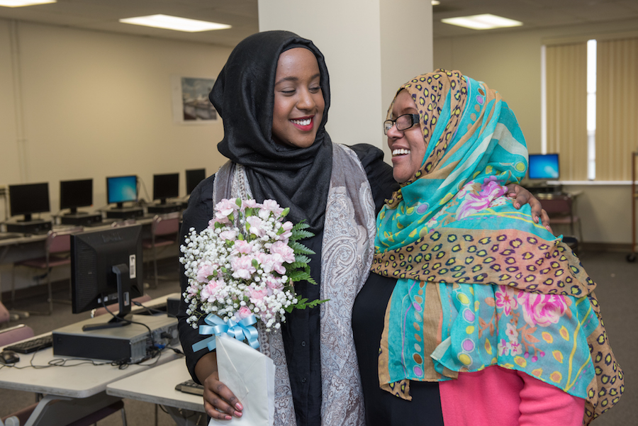 Dahir and her mom embrace during Dahir's recent stop at Focus Learning Academy, where her mother is a teacher.