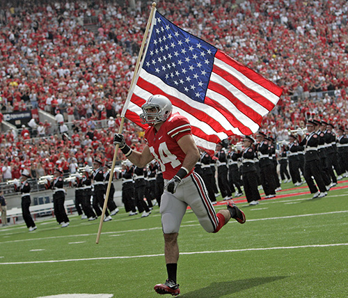 Ebner carries the American flag onto the field before a 2011 Ohio State football game.