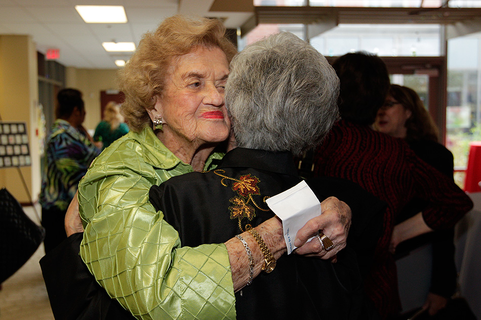 """If we have enough hugs around the world, we would show people how to love rather than how to hate,"" Schoenbaum says. ""Just wrapping your arms around someone and hugging your heart to their heart.  There is so much hate in the world, we must pass love around."""