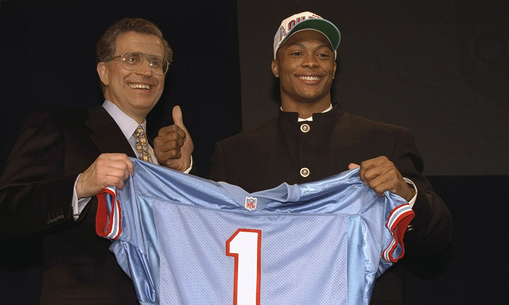 Eddie George holding his football jersey