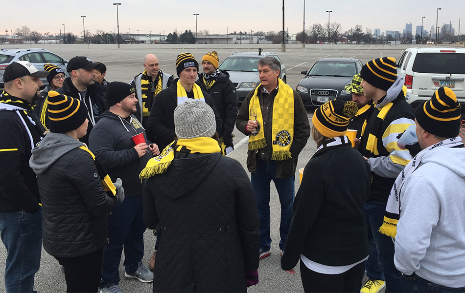 Dr. Pete Edwards with a group of diehard Columbus Crew SC supporters in the parking lot at Mapfre Stadium as dawn breaks on the first match day of the 2019 season.