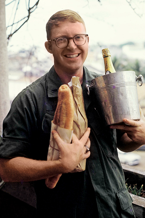 Forrest G. Brandt Jr. holding a loaf of bread and champange