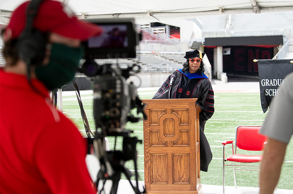 Vice President for Student Life Melissa Shivers awaits a video producer's signal to begin the first virtual commencement