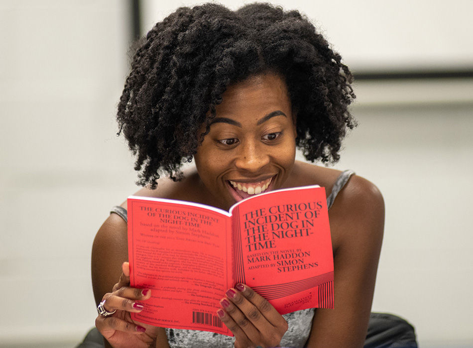 A student reads a play script