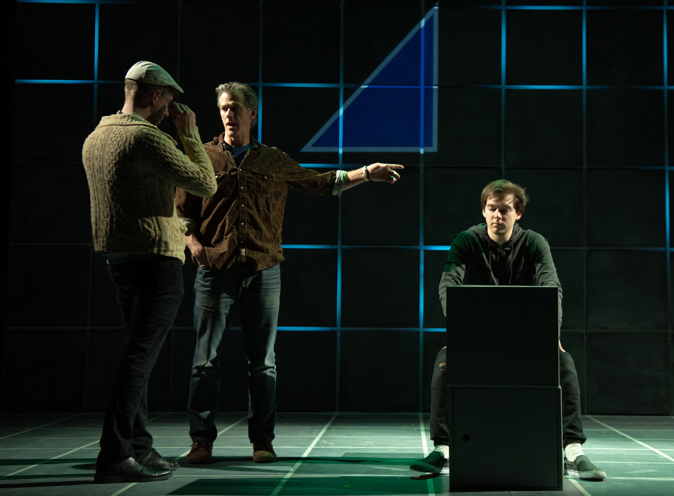 A play director speaks with actors on stage