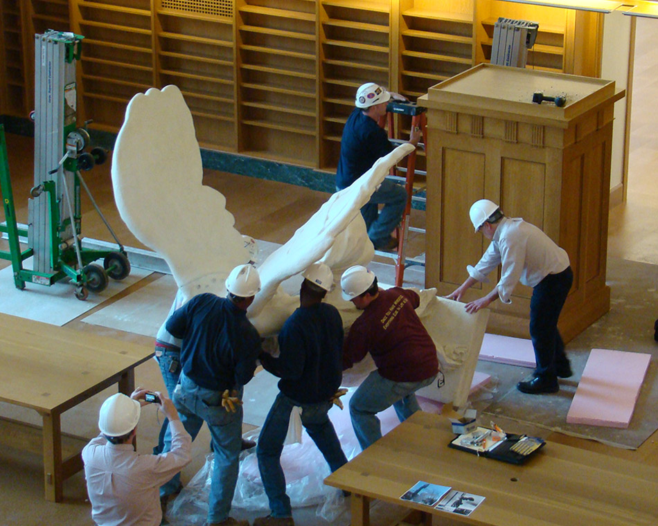 Workers install a sculpture of Nike of Samothrace in Thompson Library at Ohio State