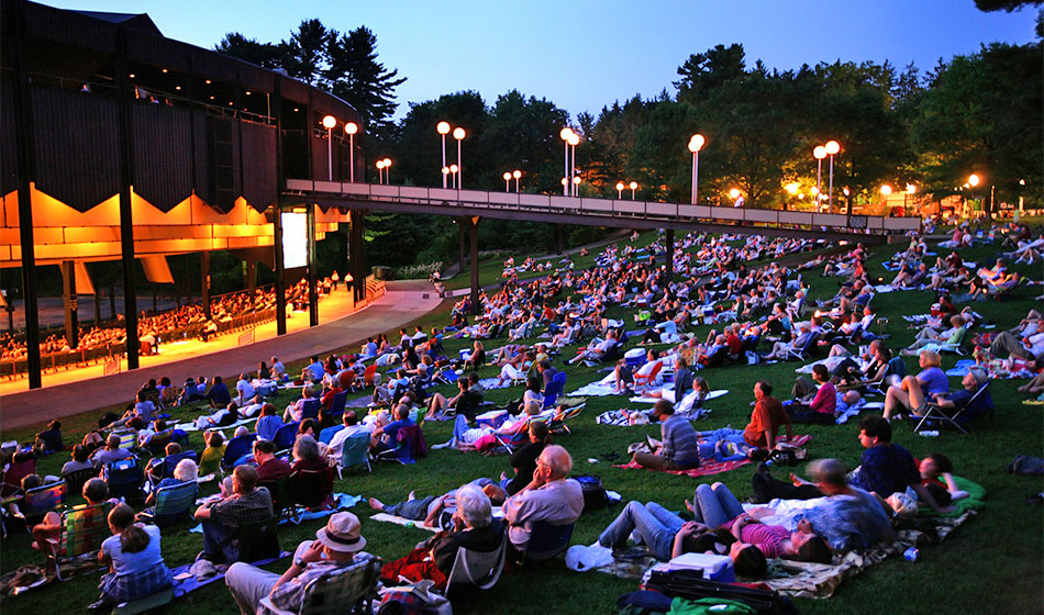 People watch a concert at the Saratoga Performing Arts Center