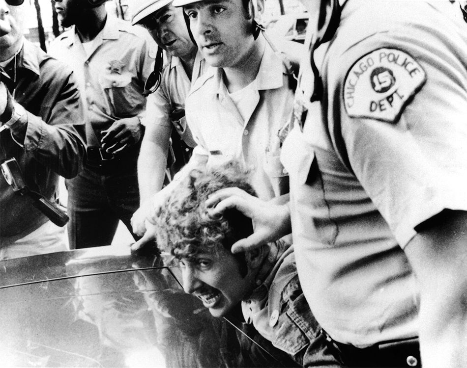 Chicago police with a protester at the 1968 Democratic National Convention