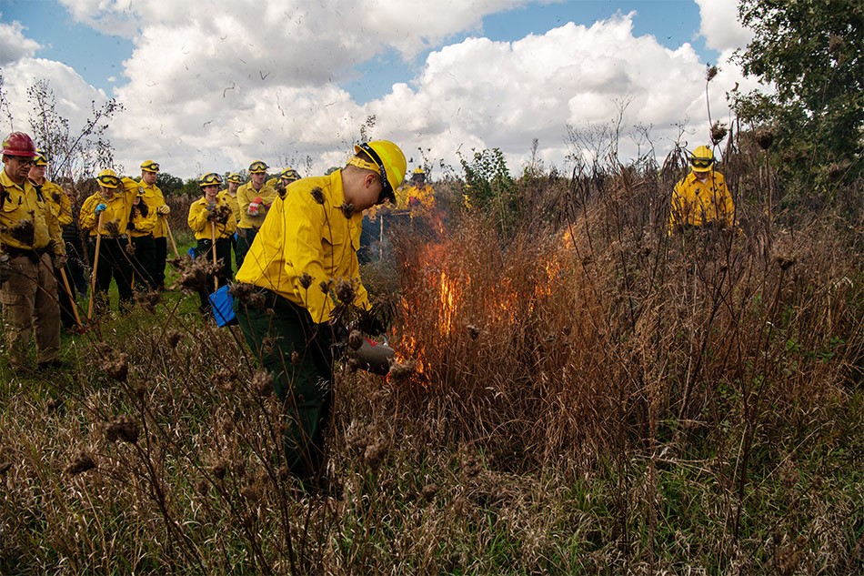 Fire management students learn to control a prairie fire