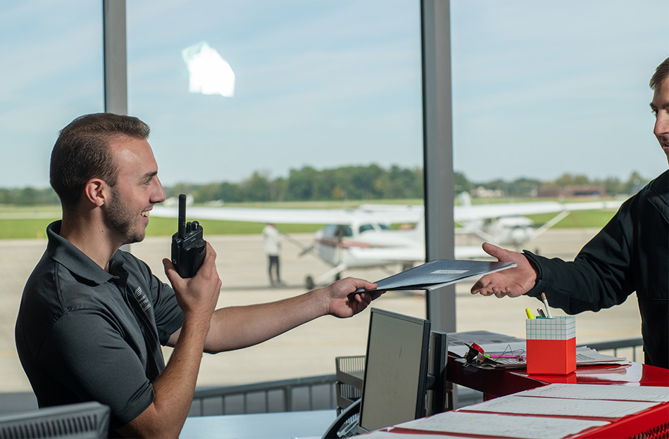 Ohio State University student Joe Atkinson at work at the university airport