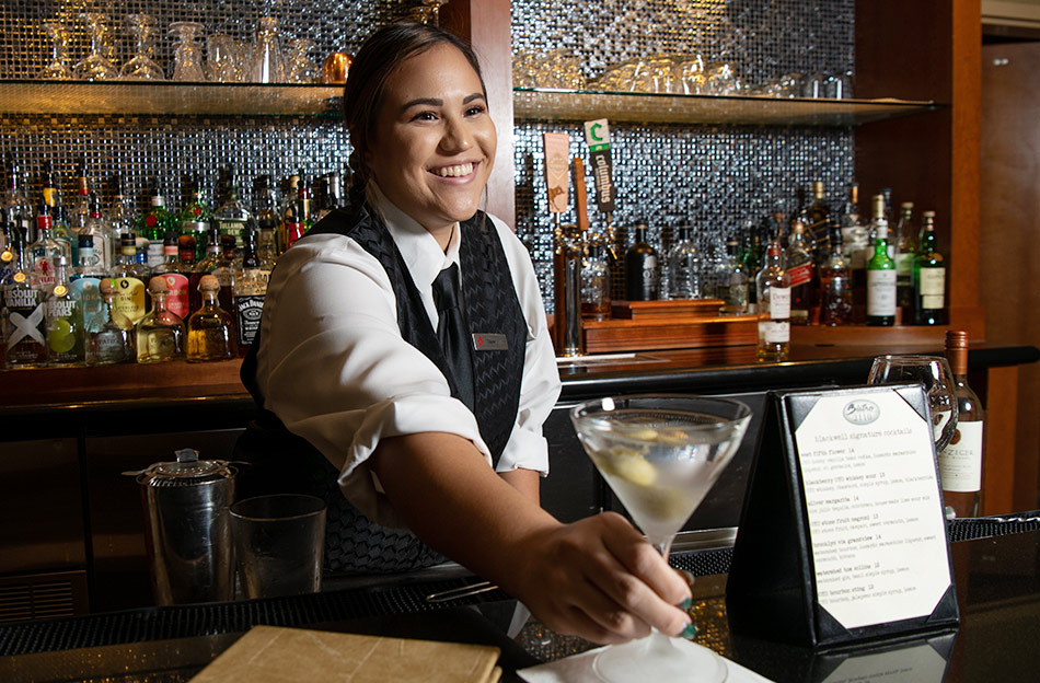 Ohio State student Taylor Cathcart at work as a bartender at The Blackwell Inn on campus