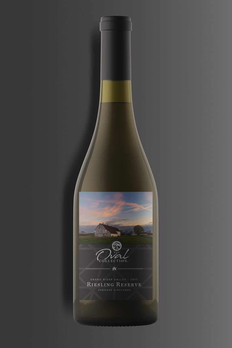 A bottle of white Riesling wine on a dark background