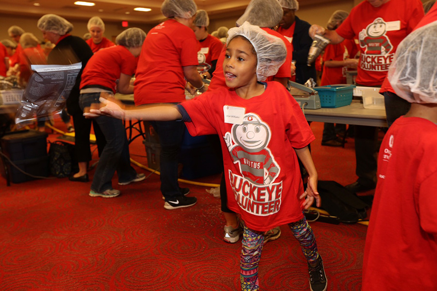 Joye Williams, 6, and her family are becoming regulars at Buckeye Volunteer events. Her mom, Beatriz Diez '04, says it's important for her children to know that they can make a difference in their community at any age.