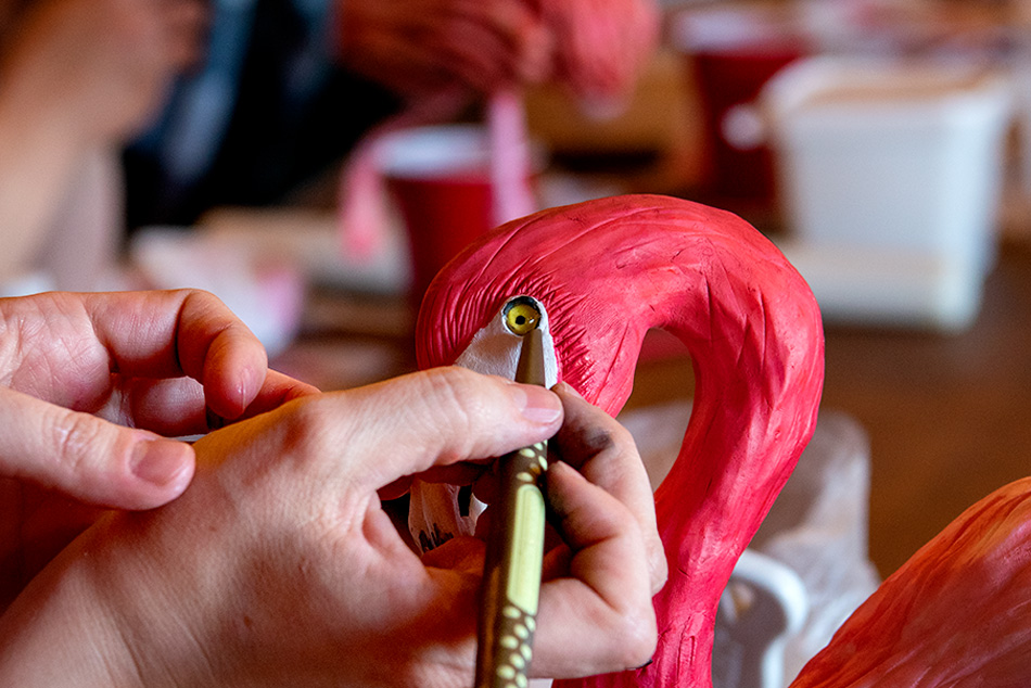 Natalie Sideserf demonstrates a sculpting technique around the eye on a flamingo-shaped cake