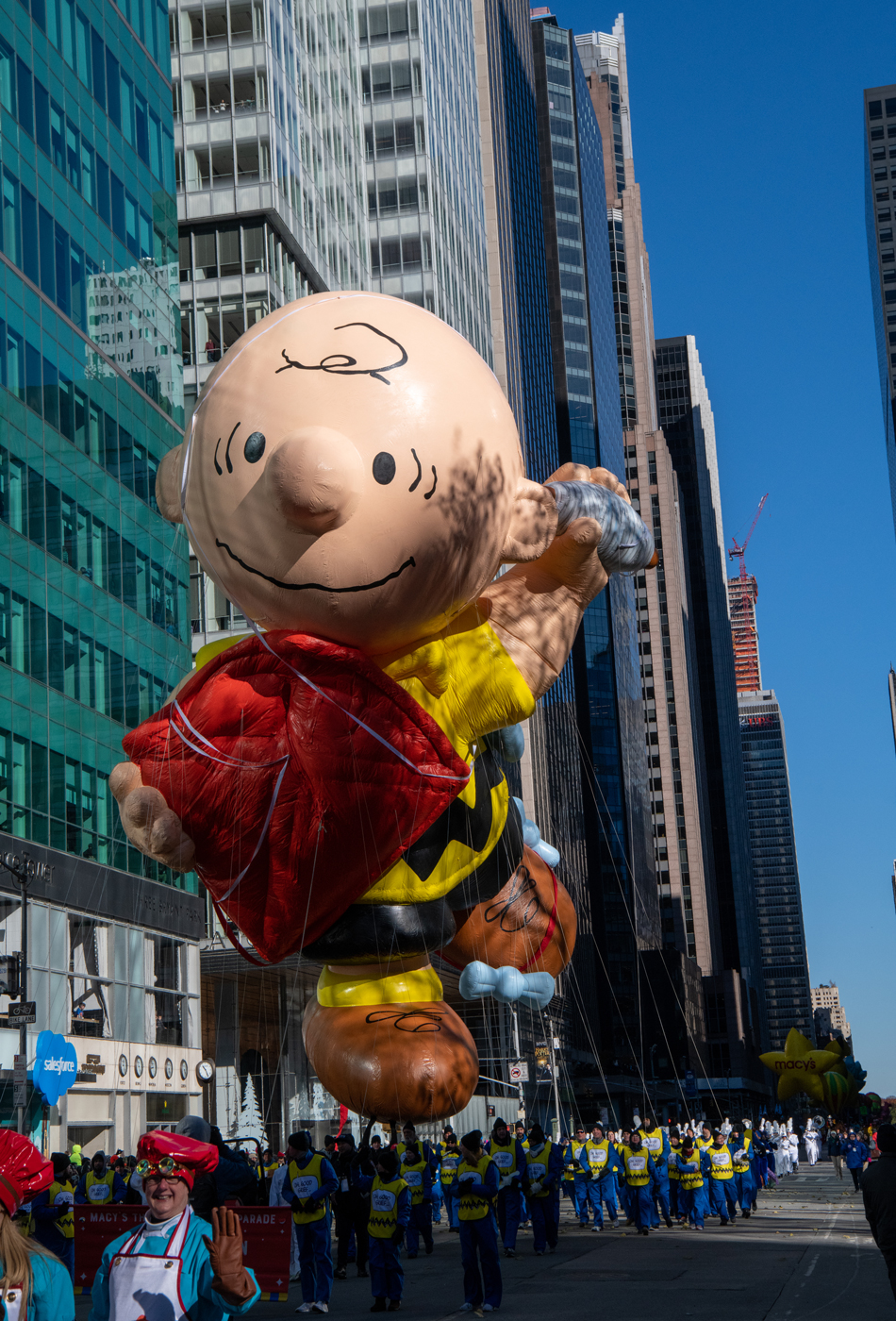 A giant Charlie Brown balloon hovers above the Macy's Thanksgiving Day Parade route in New York City on Nov. 22, 2018.
