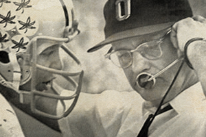 Buckeyes quarterback Rex Kern consults with coach Woody Hayes during the 1969 Rose Bowl.
