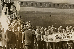 Ohio State alumni pose in front of the Pan American airplane chartered to take them to the 1969 Rose Bowl.