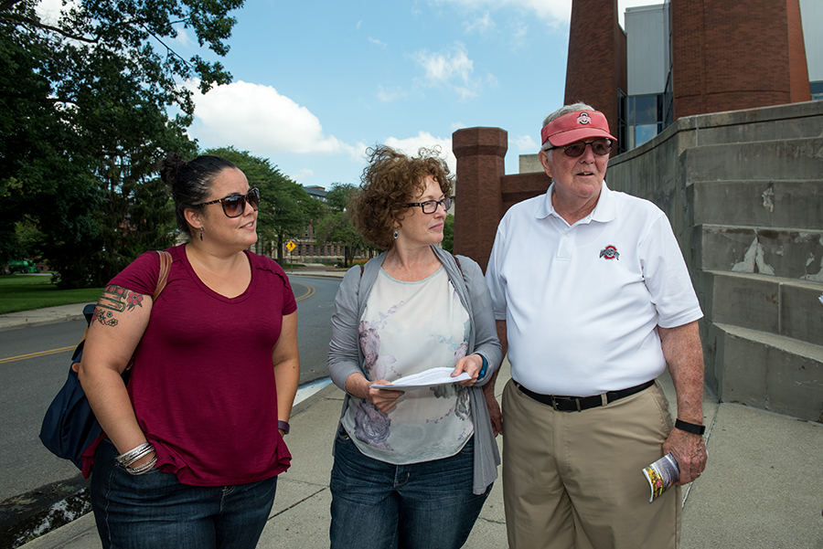 Angelica, Kristina and Ron look across campus to the next stop on their tour. Ron is surprised to discover Hagerty Hall now houses the university's language departments. He remembers it as the Commerce Building.