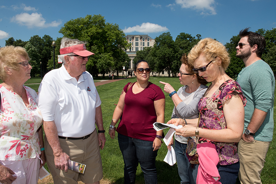 The family — from left, Nancy Ricketts, Ron Ricketts, Angelica Gutierrez Klingsmith, Kristina Ricketts Gutierrez, Karen Ricketts Lane and Toby Klingsmith — discusses the history of trees on the Oval.