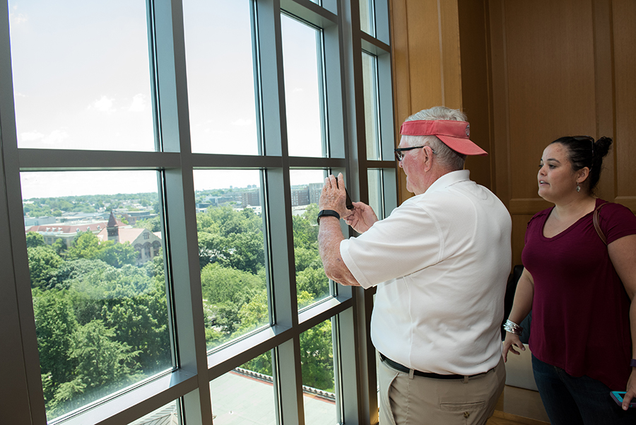 Ron Ricketts snaps a photo of the Oval from the 11th floor of Thompson Library — a view he didn't experience as a student.