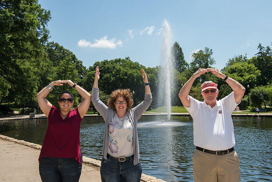 At their last stop on the tour, the family takes a commemorative O-H-I-O picture at Mirror Lake — a spot they say has become more beautiful through the years.