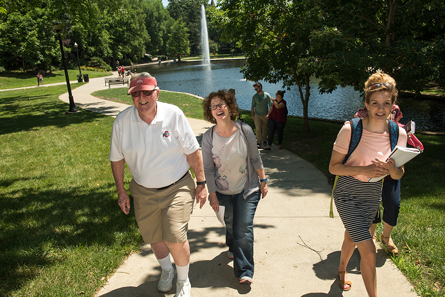 Intern Cheyenne Meek, right, joins the tour to hear the family's memories and share a bit about campus today.