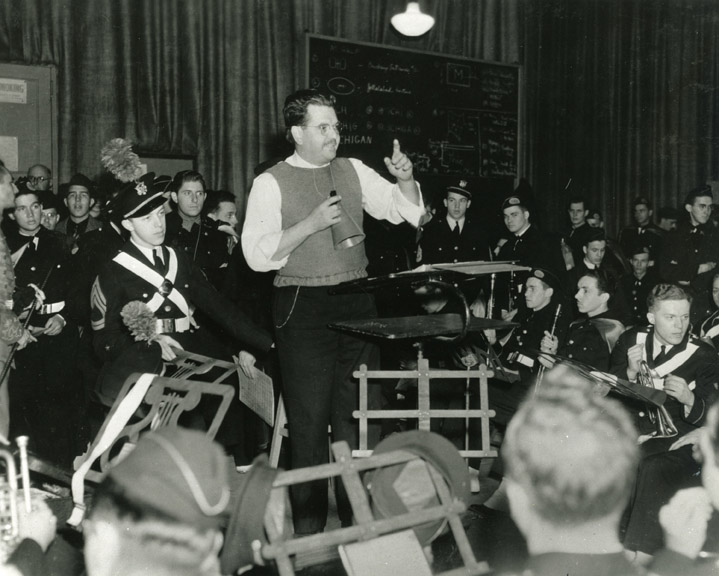 Eugene Weigel conducts a band rehearsal in 1938.
