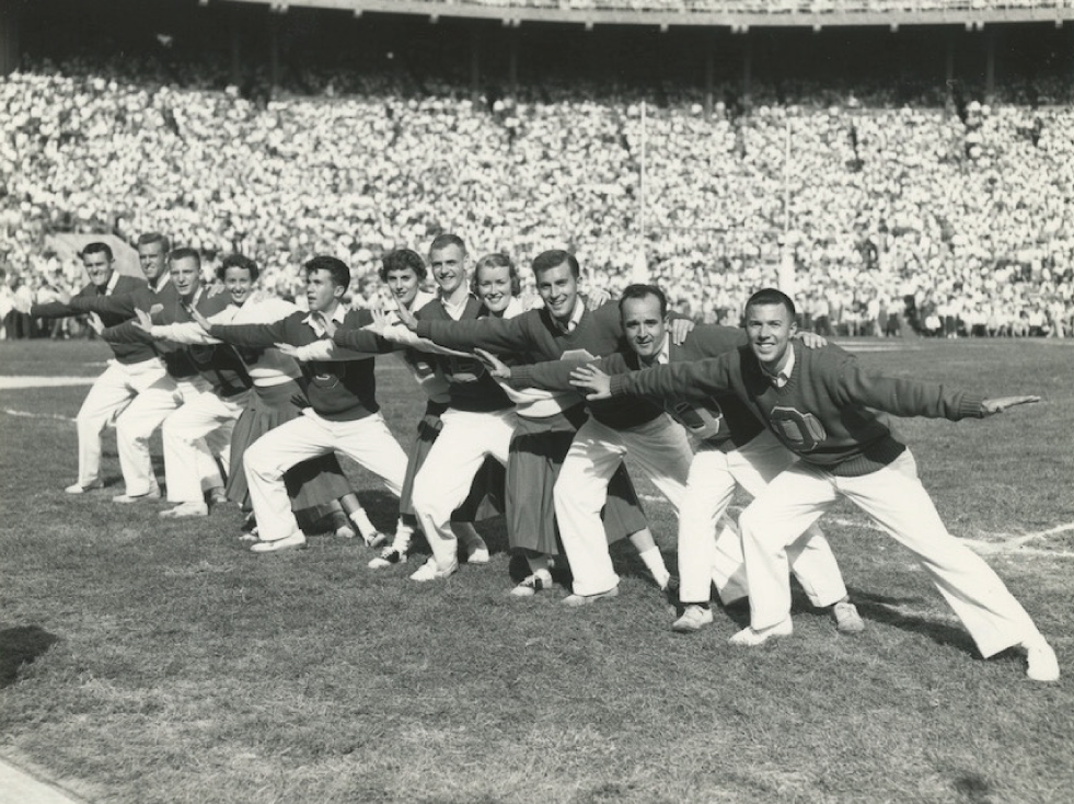 In this shot of the 1954 Ohio State cheerleading squad, Crawford is on the far left.