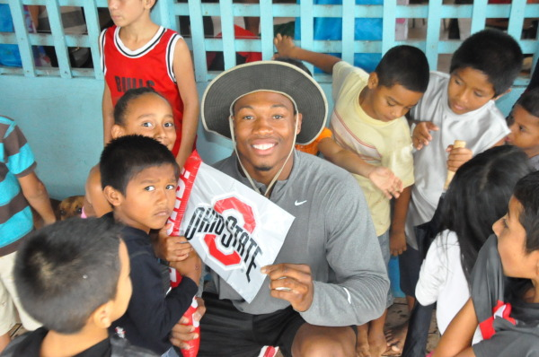 Football player Joshua Perry and a group of children show their Ohio State pride in Costa Rica.