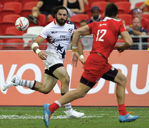 Ebner keeps an eye on the ball during USA Rugby competition.