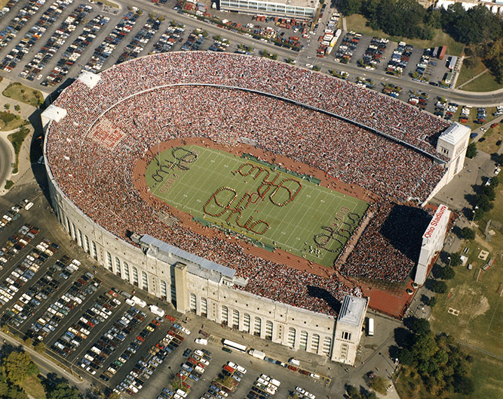 This aerial image of a packed Ohio Stadium shows a quad Script Ohio.