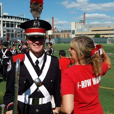 A profile photo that shows an Ohio State marching band drum major and a young woman