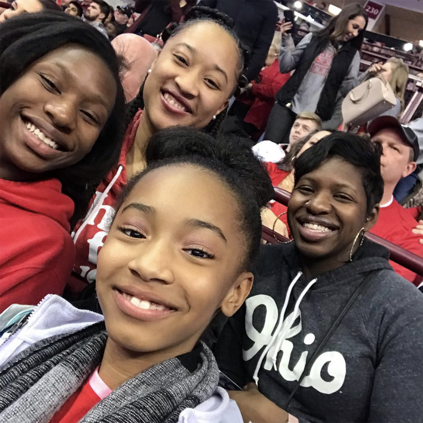 Four young women share a moment during an event at the Schottenstein Center