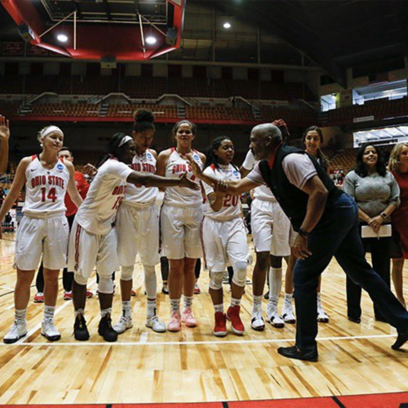 Gene Smith shakes handss with members of the OSU Womens basketball team.