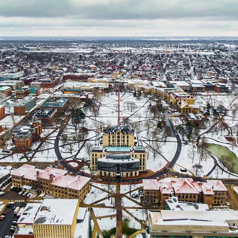 A photo featuring an aerial view of the snow-covered oval.