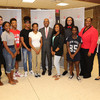Ohio State President Michael V. Drake poses with a group of students at a college affordability forum in Youngstown.
