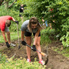 Ohio State students cultivate the soil during a visit to the Civic Garden Center of Greater Cincinnati.
