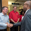 Ohio State President Michael V. Drake greets Shane Meeker, Procter & Gamble's corporate historian. Meeker is a 1997 graduate of Ohio State.
