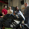 Prince Albert II of Monaco meets with Ohio State faculty and students who are explaining progress on Buckeye Current, an electric motorcycle developed at Ohio State's Center for Automotive Research.