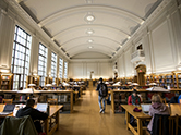 Library reading room filled with students